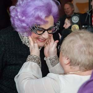 Dame Edna saying hello to a customer