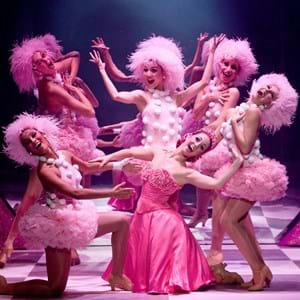 Dancers in pink with pink wigs